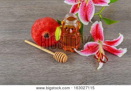 Rosh Hashanah Jewesh Holiday Concept - Pomegranate Honey Pink Lilies Jewish Food, Symbol,
