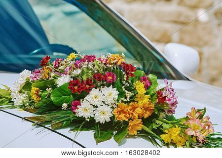 Image of Wedding Bouquet on the Car Bonnet