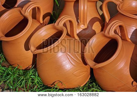 Image of Row of Pitchers on the Grass