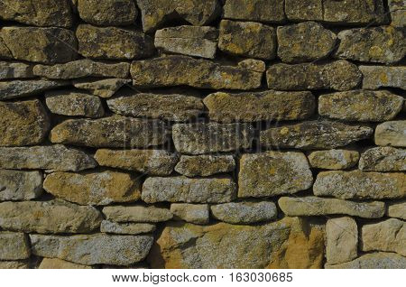 Honey coloured, typical Cotswold dry stone wall