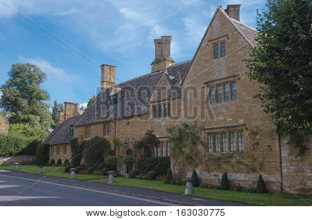 Typical honey coloured Cotswold house on a sunny day