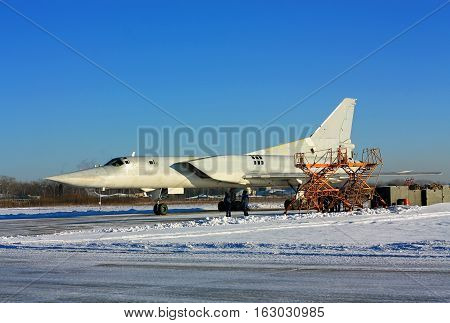 Russian bomber parked at a military airbase for service