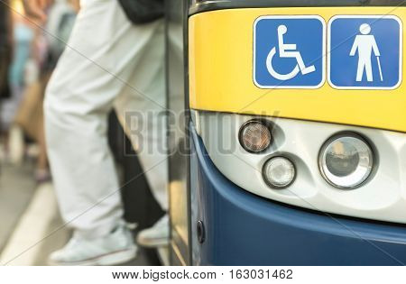 City bus. Signs with handicap symbols. Bus mobile fast city transport.
