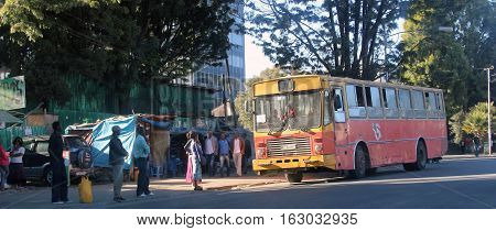 An old bus and local people on streets of Addis Ababa, Ethiopia, february 2015