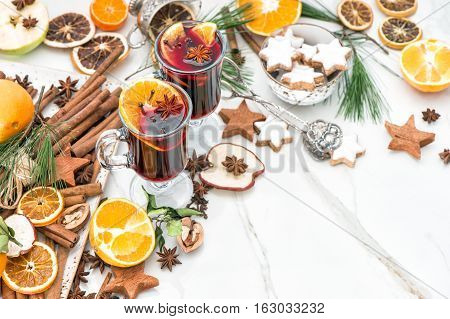 Mulled wine ingredients on bright background. Hot red punch with fruit and spices. Christmas food and drinks