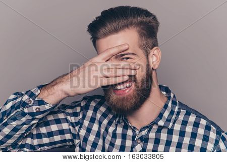 Funny Cute Young Man With Beard Hiding His Face With Palms And Show Eye