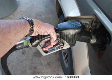 Hand Pumping Gas Fuel Into Auto