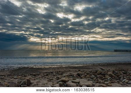 Divine sun beams through the clouds on the Ventura horizon.