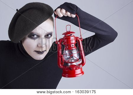 Young beauty, woman mime with red lantern