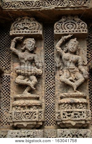 Exquisitely carved wall panel depicting a lady musician and a dancer at Sun Temple Konark Orissa India Asia