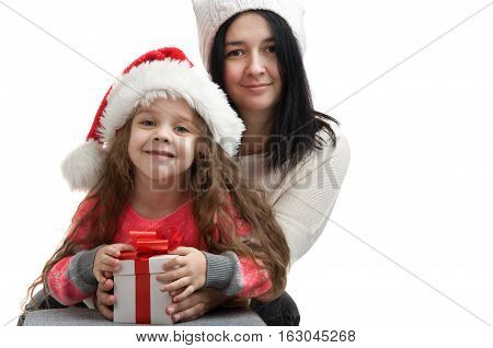 happy family. Children and mom in Christmas clothes. Children received presents from mom