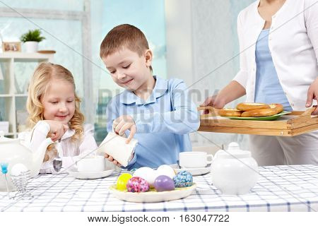 Children drinking tea at their granny s at Easter