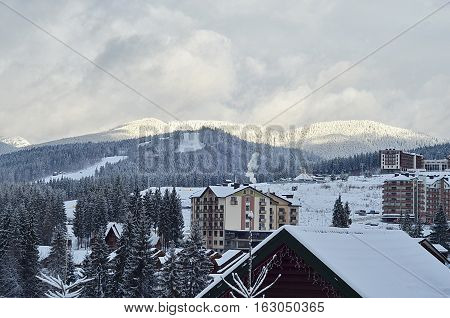 BUKOVEL, UKRAINE - DEC 04, 2016:Beautiful winter landscape with snow covered trees on a mountain ski resort in Bukovel. Bukovel is a most popular ski resort in Ukraine
