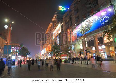BEIJING CHINA - OCTOBER 24, 2016: Unidentified people visit Wangfujing shopping street.