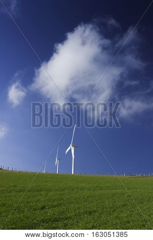 Spain Galicia row of wind turbines on a hill morning light