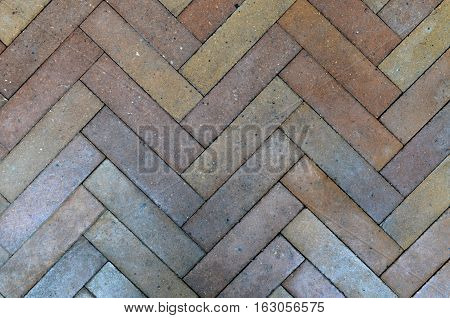 Arrow brown brick floor for background and texture