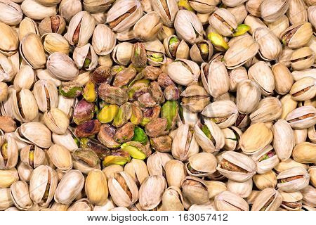 Background with roasted and salted pistachios - Macro photography