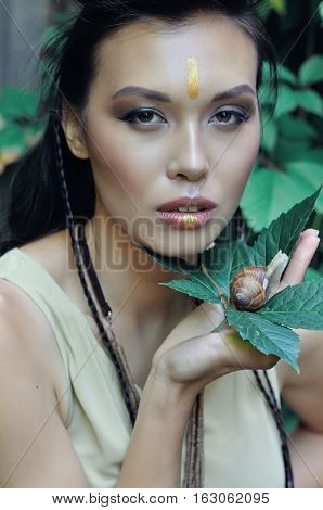 Beautiful Girl Holding A Snail In Hands