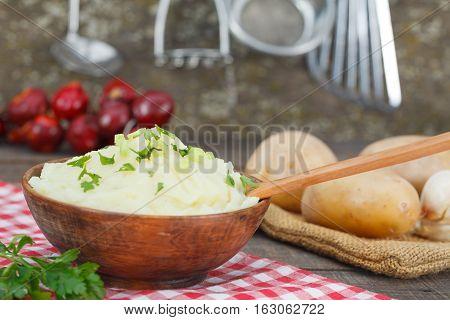 Homemade, delicious mashed potatoes in rustic style kitchen