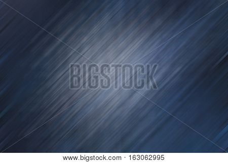 dark blue background with lighter area in the middle with soft pattern of lines going obliquely