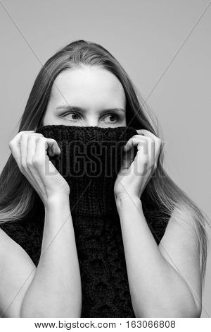 Model covered face with collar sweaters, black and white photo