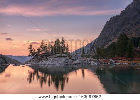 Sunset Mountain Lake With Pink Calm Waters, Altai Mountains Highland Nature Autumn Landscape Photo. Beautiful Russian Wilderness Scenery Image.