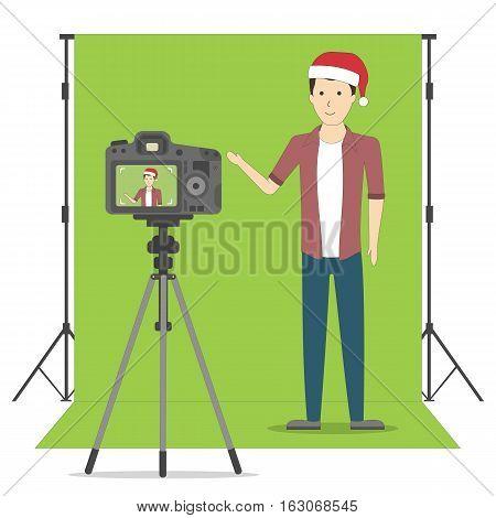 Christmas blog recording on chroma key background. Vlog. Video recording. Handsome boy in santa hat.