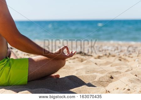 Guy relaxes on picturesque seaside calm day