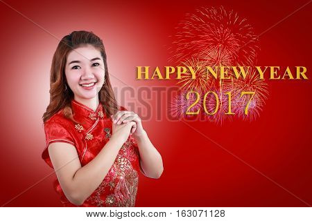 Happy new year 2017 and Chinese new year.Smile Chinese woman dress traditional cheongsam and introduce on red background.