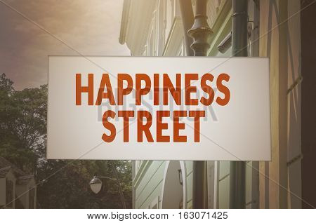 Happiness street signboard. Retro, vintage toned image.