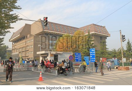 BEIJING CHINA - OCTOBER 25, 2016: Unidentified people visit Peking University. Peking University is the first modern national university established in 1898 in China