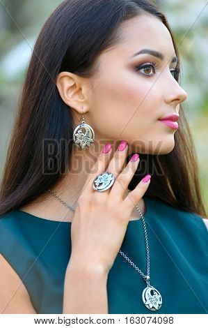 model shows decoration from the spring collection jewelery and accessory