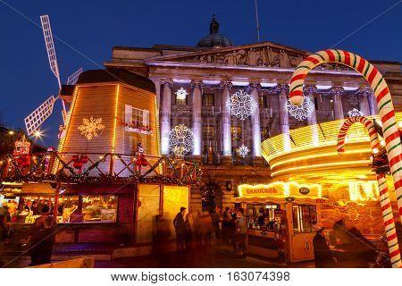NOTTINGHAM ENGLAND - DECEMBER 22: Merry go round at Nottingham Christmas Market at night. In Nottingham England. On 22nd December 2016.