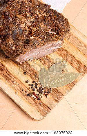 Baked Pork With Herbs And Spice On Wooden Board.