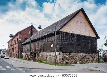 Liepaja, Latvia - July 24, 2016: View Of The Street With Wooden And Brick Buildings