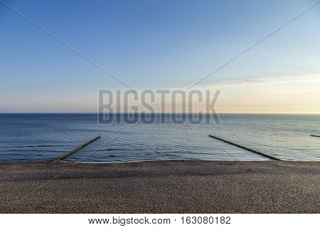 Beach Landscape With Wooden Wave Breakers