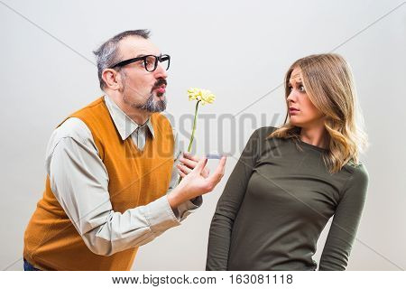 Nerdy man wants to marry to a beautiful woman but she is terrified, she doesn't want to marry.