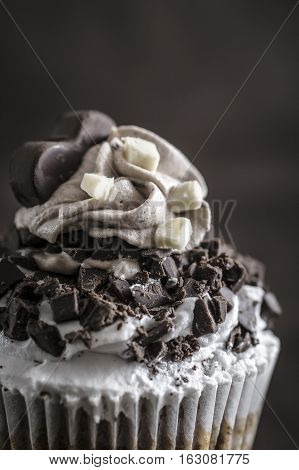 Closeup of chocolate cupcake over wooden background