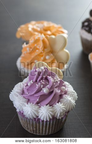 Valentine cupcakes on table,  close up photo