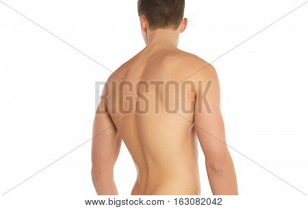 Sports And Fitness Topic: Naked Sporty Man Standing Back Isolated On A White Background In The Studi