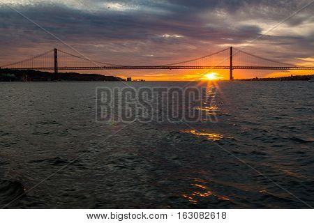 Tagus River, Bridge April 25 Lisbon at sunset, Portugal