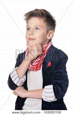 handsome little boy posing against white background