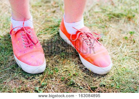 Body parts.Close-up shooting of girl's feet wearing pink sneakers