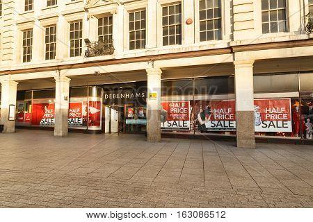 NOTTINGHAM ENGLAND - DECEMBER 26: Half price sale posters in windows at Debenhams. In Nottingham England. On 26th December 2016.