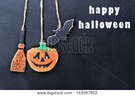 handmade cookies for Halloween and greeting inscription. The empty space beneath the inscription can be used for writing or drawing particular congratulations. Can be used as greeting card