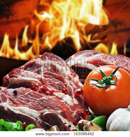 fresh pieces of steak and vegetables for grilling