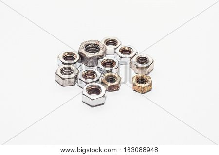 Used old bolts and nuts with isolated white background for commercial