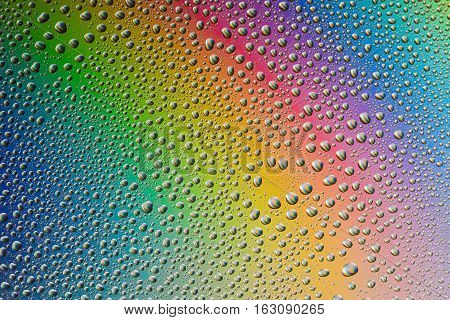 misted glass, the drops closeup on rainbow colored background