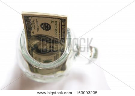 savings dollars in glass jar on white background. - Investment and interest concept