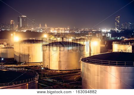 Night view selective focus Oil Tanks for background